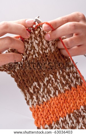 woman's hand knit knitting yarn and clothes - stock photo