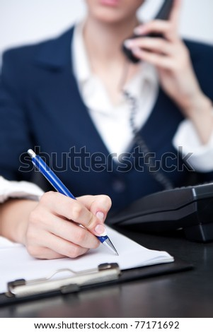 woman's hand making note, close up - stock photo