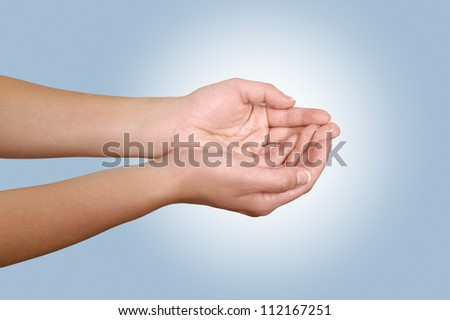 Woman's Hand on gray bacground
