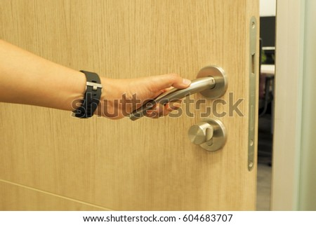 womans hand open private offices door stock photo royalty free
