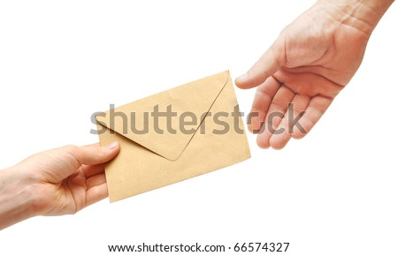 woman's hand passes the envelope male hand - stock photo