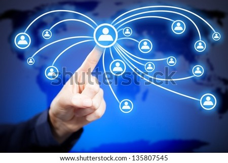 Woman's hand pushing social media button on touch screen - stock photo