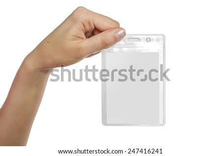 Woman's hand showing blank name badge. Isolated on white - stock photo
