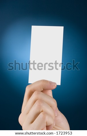 woman's hand shows card - stock photo