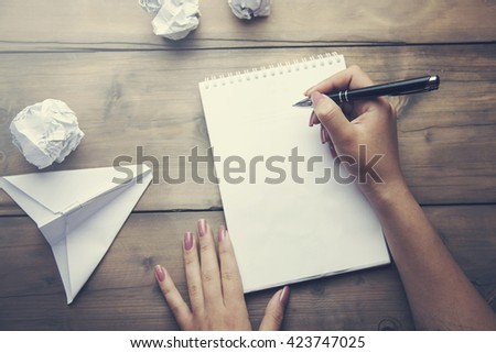 woman's hand take the paper plane - stock photo