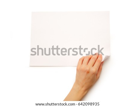 Woman's hand turning over sheet of paper