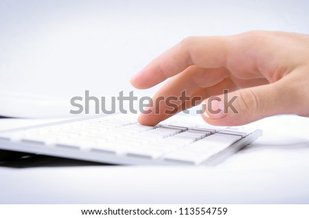 Woman's hand typing on computer keyboard
