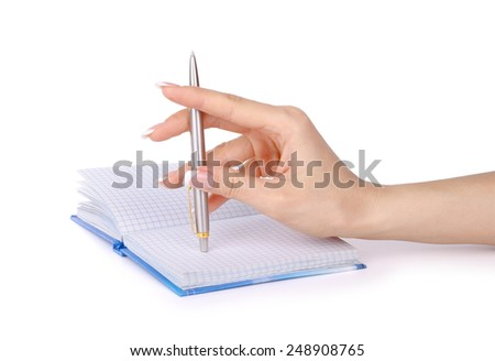 Woman's hand with a pen writes in a notebook. - stock photo