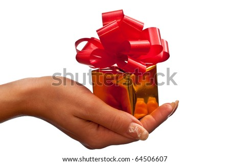 Woman's hand with a small gold gift box with big red bow isolated on white background - stock photo