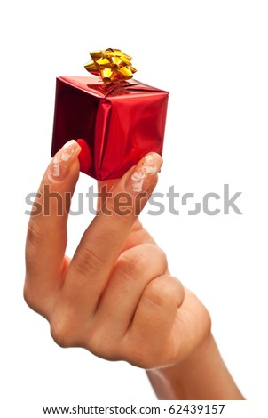 Woman's hand with a small red gift box with gold bow. White background - stock photo