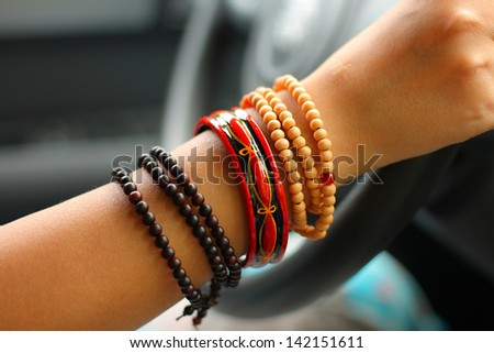 Woman's hand with bracelet and beads - stock photo