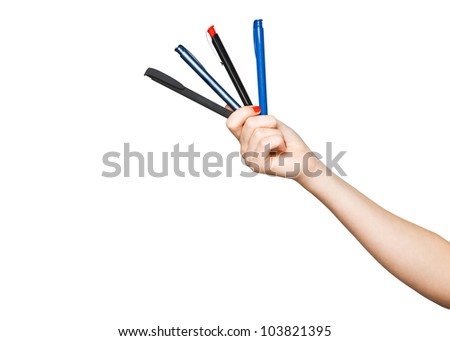 woman's hand with four pens isolated on white background - stock photo