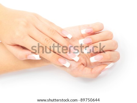 Woman's hand with French manicure on white background - stock photo
