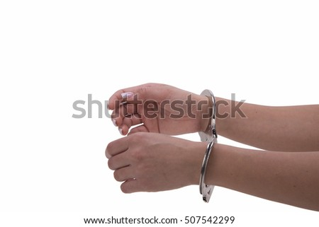 woman's hand with handcuffs on white background