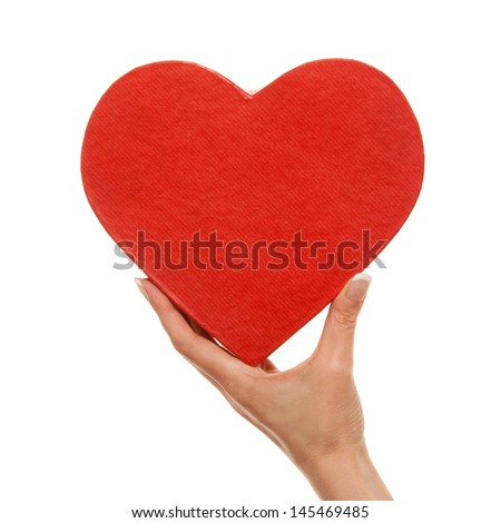 Woman's hand with heart - stock photo