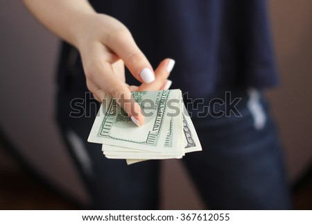 woman's hand with money - stock photo