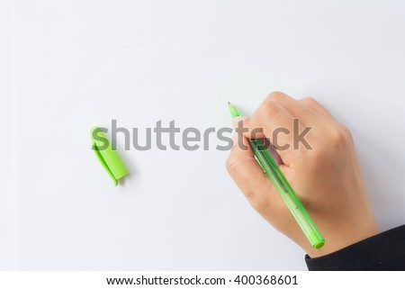 Woman's hand with pen on a white background. - stock photo