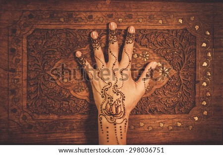 Woman's hand with traditional menhdi henna ornament  - stock photo