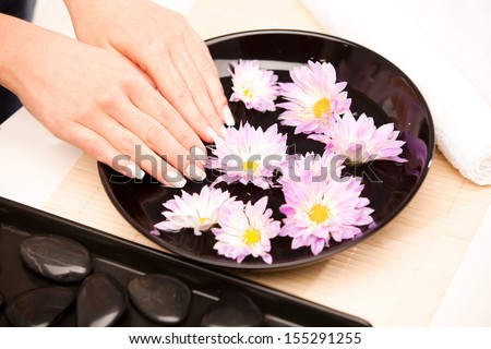 Woman's hands at spa procedure - stock photo