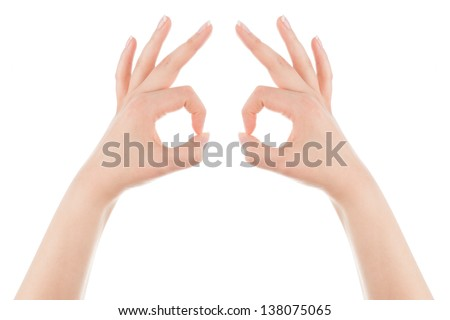 Woman's hands form the mask gesture on a white background.