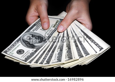 Woman's hands holding a bunch of hundred-dollar bills - stock photo