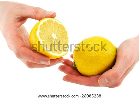 Woman's hands holding citrus fruits (lemon) isolated on a white background - stock photo