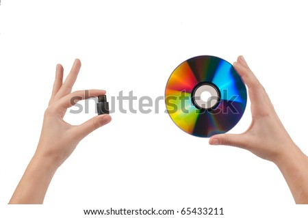 Woman`s hands holding pen drive and disc isolated on white background - stock photo