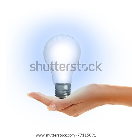 woman's hands holding shiny lamp