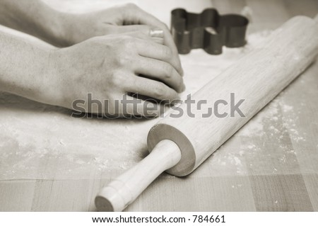 Woman's hands kneading dough for baking cookies - stock photo