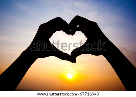 woman�s hands made in the form of heart - stock photo