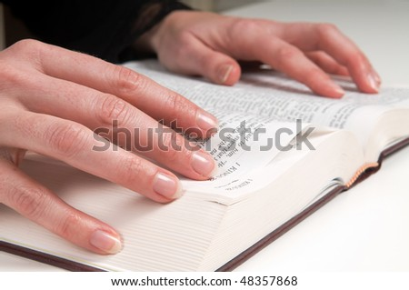Woman's hands on a Bible, studying and reading.