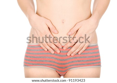 Woman's hands on stomach, isolated on white background - stock photo