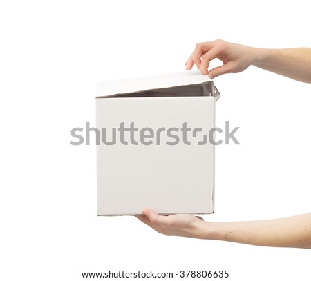 Woman's hands opening white box - stock photo