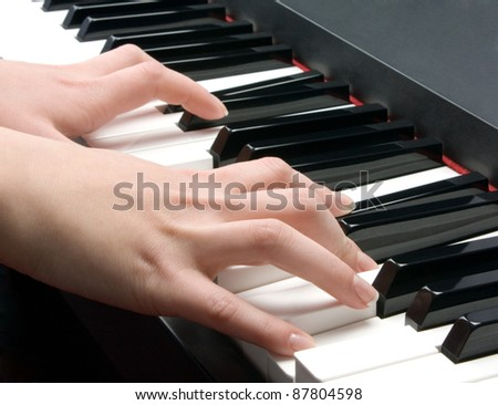 woman's hands playing the piano - stock photo