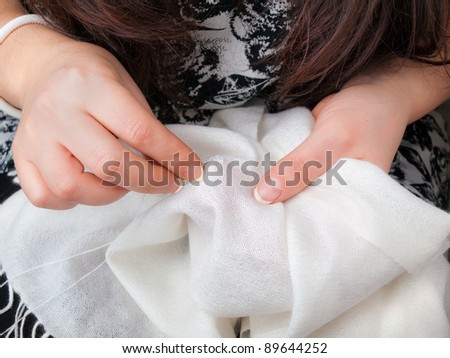 woman's hands sewing - stock photo