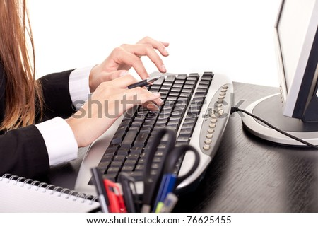 woman's hands typing in office, secretary typing - stock photo