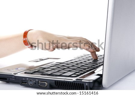 Woman's hands typing on the laptop