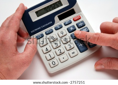 Woman´s hands using an electronic  calculator, close-up, isolated on white - stock photo