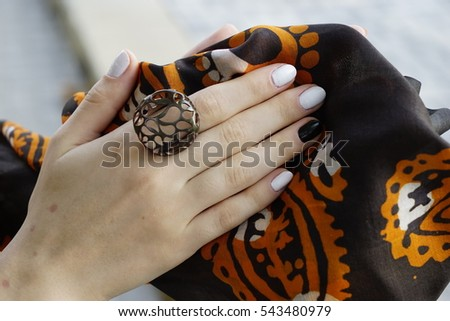 woman's hands with jewelry rings.close-up beauty and fashion portrait.