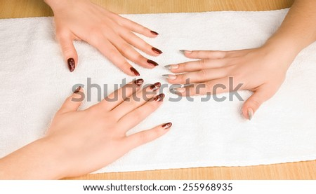 Woman's hands with manicure - stock photo