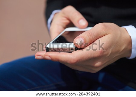 woman's hands with mobile phone