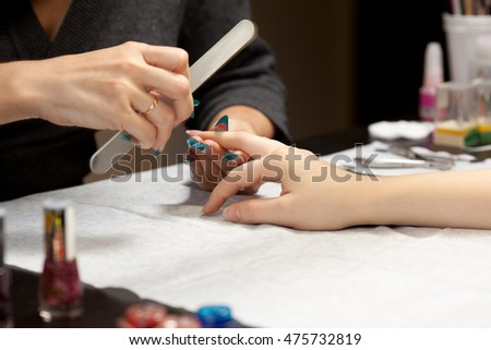 Woman's hands with nail file
