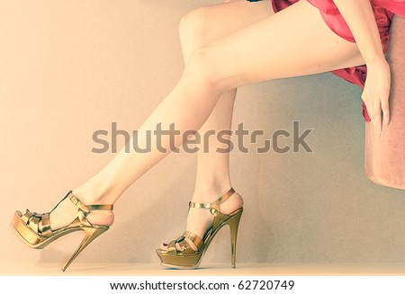 Woman's leg and high heel shoes - stock photo