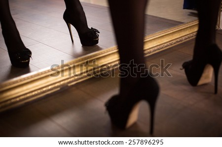 Woman's leg in high heel stiletto fetish boots - stock photo