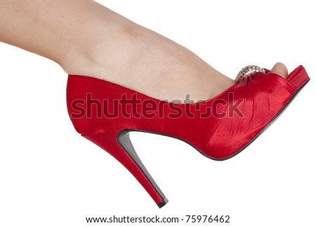 Woman's leg in red shoe and nylons. Isolated on white background - stock photo