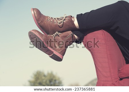 Woman's legs close up lying on couch. Edited image with vintage effect - stock photo