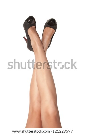 Woman s legs fetish with black shoes - stock photo