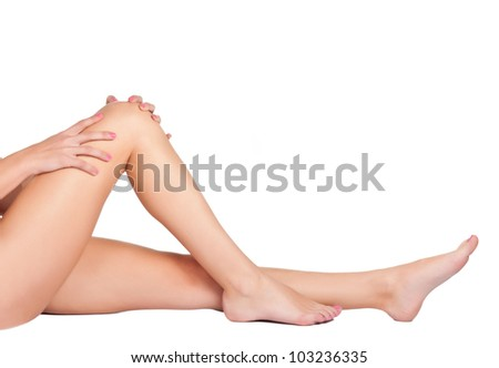 Woman's legs isolated on a white background - stock photo