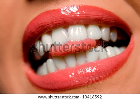 Woman's lips teeth and tongue close-up - stock photo