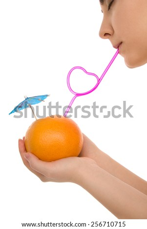 Woman's lips with fruit and pink straw isolated on white - stock photo